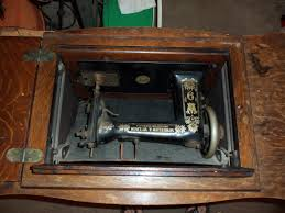Machine retracted into Treadle cabinet  Treadle Sewing Machines