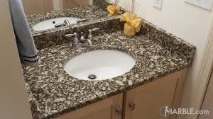 florence gold granite bathroom with his and her sinks marble com