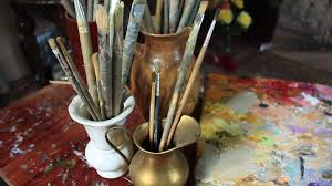 art studio oil painting material large and small brushes stock footage blocks