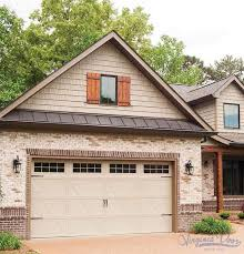 steel carriage house garage doors with overlay