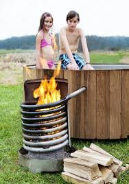 wood fired the dutchtub wood is a wood fired outdoor hot tub a fire in the coil warms the water in the tub natural circulation causes the colder