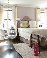 feminine bedroom with clear hanging egg chair papercity