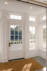 love the white door. maybe as a front door or as a service door to garage.  Could add a sheer white window covering to door window.