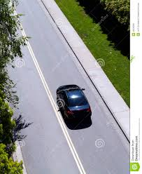 car driving down road. Perfect Down Car Driving Down Road From Above Green Grass Inside N