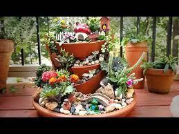 a fairy garden w yabani figurines
