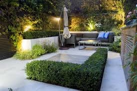 outdoor room in sloane square chelsea with gloster exterior furniture and lighting and timber decking