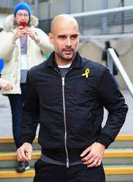 Why Pep Guardiola Keeps Ripping the Tags of His Designer Jackets