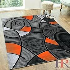 orange area rug on blue rugs and grey gray