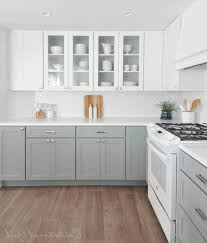grey cabinets in kitchen natural wooden table yellow wooden table simple wooden floorboard black wooden table with marble countertop