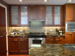 wood wall mounted oak kitchen cabinet with marble coutnertop and opaque glass cabinet doors plus ceramic backsplash ideas