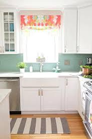 white kitchen with aqua glass tile backsplash mosaic