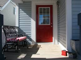 Blue House With A Red Front Door For The Home Red Door