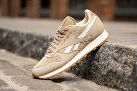 each is accented with crisp white striping tan leather accents and gum rubber outsoles the summer suede pack is available now at select reebok classic