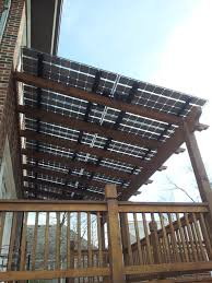 deck shaded by solar panels modern patio