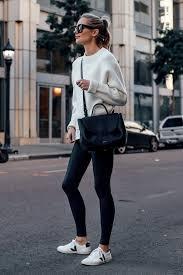 blonde woman wearing allsaints white sweater white tshirt spanx black faux leather leggings veja espalar white