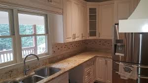 charleston white with a charleston saddle island job completed with new cabinetry and granite