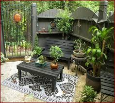wood patio ideas on a budget.  Patio Backyard Patios Ideas With Rectangle Table Wooden Chair Decorative Plants  On Floral Rug And Iron  Wood Patio A Budget