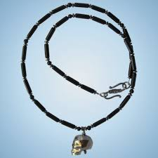 black swarovski crystal skull pendant on necklace of black obsidian with hematite accents
