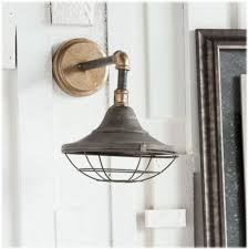 subway wall sconce light fixture iron brass steel with cage base