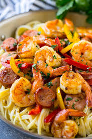 this recipe for cajun shrimp and sausage pasta is sauteed shrimp and smoked sausage with colorful