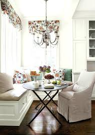 coffee nook seating breakfast nook benches armchair round table throw pillows curtains recessed panel cabinets hardwood