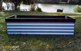 raised wooden corrugated iron garden bed