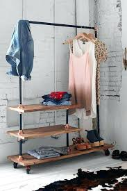 clothes storage shelves wood and blackened steel rack with several shelves baby clothes storage shelves clothes storage shelves