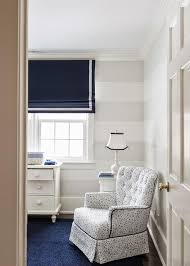 nursery with white and gray stripe walls
