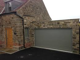hormann l ribbed sectional in stone grey by abi garage doors hormann l ribbed