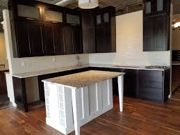 Black Shaker Showroom Cabinets With Contrasting White Island Spice