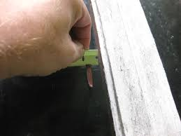 just hold the blade flush against the glass and it will l off the paint without scratching your window a razor will remove cellophane tape and its