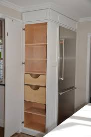 glass building kitchen cabinets. kitchen pantry cabinet. refrigerator cabinet with side pantry. how to use every inch of glass building cabinets e
