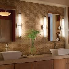 mosaic tile walls and bathroom lighting with bathroom mirror also vessel sink and vanity cabinet