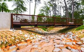 the mercer botanic garden newly built metal pedestrian bridge was installed to replace the wooden one