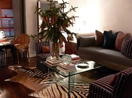 the glass coffee table is from ralph lauren the zebra rug from patterson flynn and martin