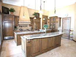 cool dark varnished kitchen cabinet set and island with dark granite countertop and copper ceiling lamp
