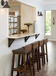handmade living room furniture. a window was cut between the living room and kitchen to create breakfast bar with handmade furniture l
