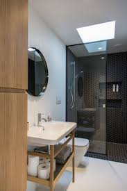 The home's compact bathroom is located in its central service core.  Photograph by Jeremy Toth