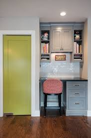 office in kitchen. kitchen desk by pantry with door painted in a similar color office