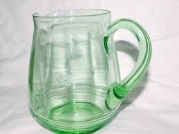 vintage pale green depression glass pitcher 7 1 2 tall etched flowers pattern