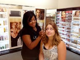 l oreal paris pro makeup artist brandy gomez duplessis giving leah mega lashes with l oreal paris new power volume 24hr mascara