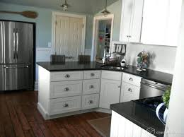 black quartz countertops white cabinets black and white beach cottage kitchen traditional kitchen white kitchen cabinets with dark gray quartz countertops