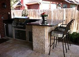 patio outdoor kitchen with counter top and bar stools