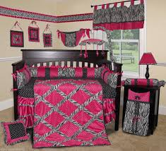alluring baby girl bedding ideas with black color wooden baby crib and black white pink colors bedding set