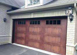 how much does a two car garage door cost cost of new garage door installed average cost to replace two car garage door average cost 2 car garage door