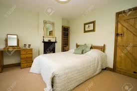 Pale Green Bedroom Bedrooms With Wooden Furniture And Pale Green Walls Stock Photo