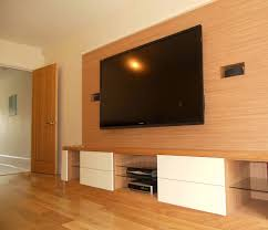 large wood wall covering idea for big flat tv and cabinet