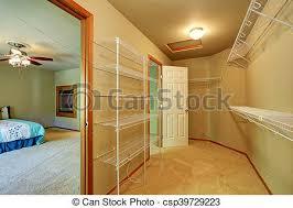 empty walk in closet. Empty Walk Through Closet With Shelves In The Bedroom. - Csp39729223 Empty
