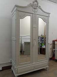 white armoire wardrobe with mirror door on cozy