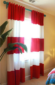 red rugby striped curtains with light bluish walls